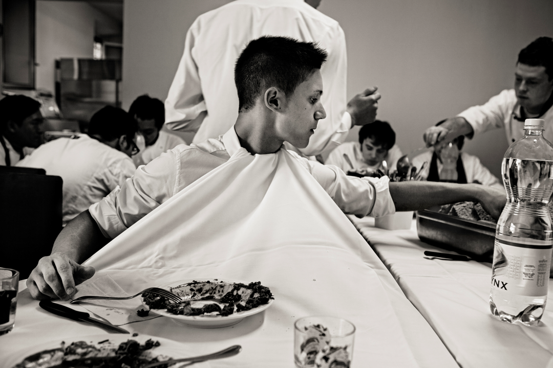 A waiter keeps his shirt clean for service. Osteria Francescana, Modena, Italy. Photo by Per-Anders Jörgensen