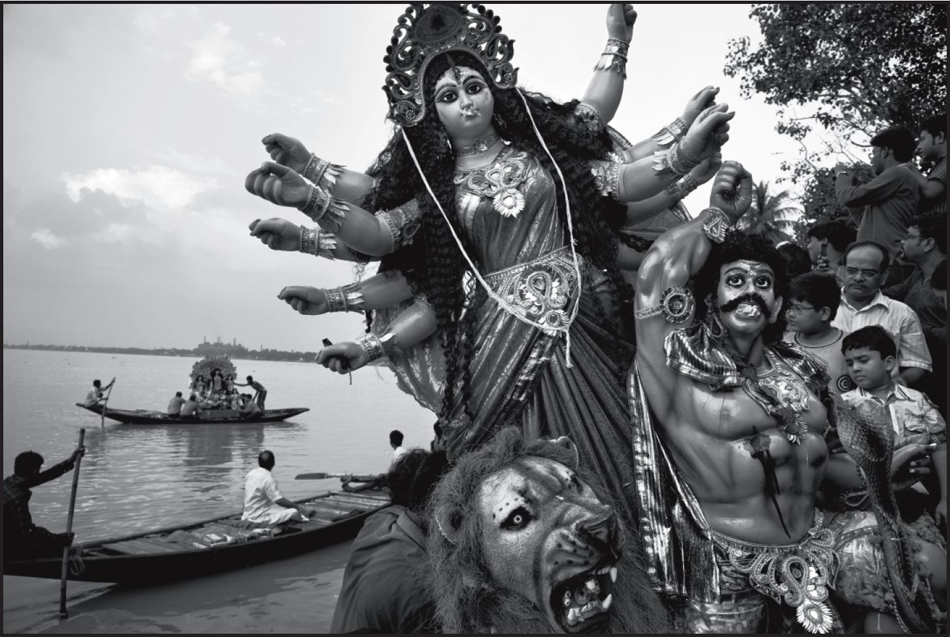 Abbas. Devotees drown a statue of Durga, the Bengali avatar of goddess Kali, in the river Hoogly; Kolkata, India. © Abbas / Magnum Photos