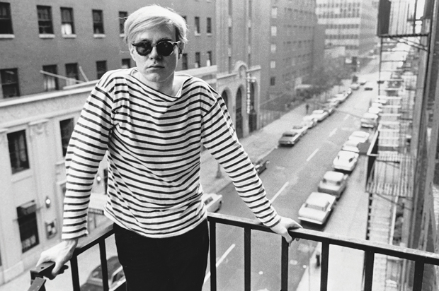 Andy Warhol on the fire escape of the Factory, 231 East 47th Street, 1965-7 by Stephen Shore, as reproduced in Factory: Andy Warhol