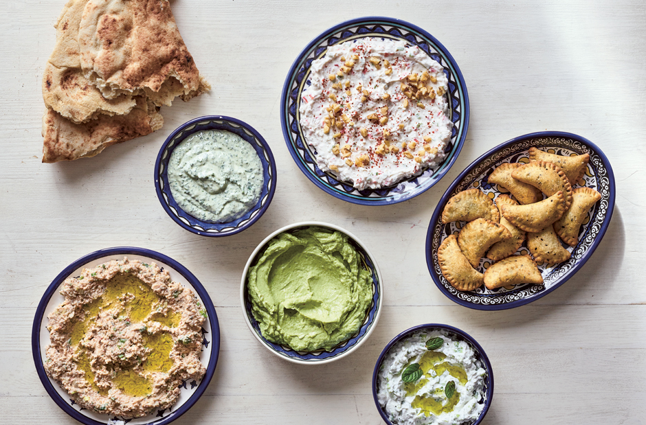 Dips and Small Bites: clockwise from left: Taboon Bread; Parsley or Cilantro (Coriander) Tahini Spread; Walnut and Garlic Labaneh; Deep-Fried Cheese and Za'atar Parcels; Garlic and Cucumber Labaneh; Avocado, Labaneh, and Preserved Lemon Spread; Labaneh And Bulgur Spread