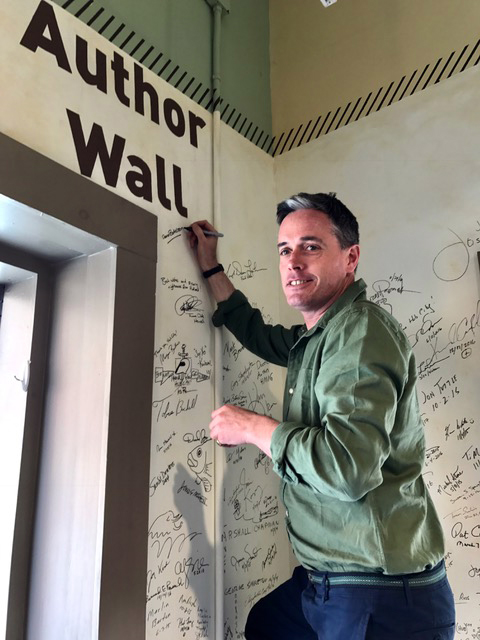 Aaron signs the author wall at Hub City Bookshop & Press, Spartanburg, South Carolina