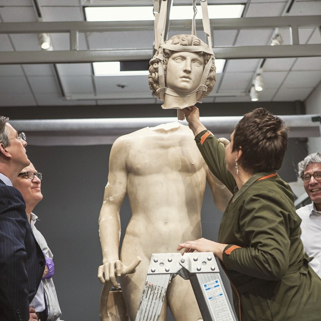 The Metropolitan Museum's Carolyn Riccardelli,  Lawrence Becker, and Michael Morris re-attach the head of Tullio Lombardo's Adam, observed by director Thomas Campbell. Photograph by Chris Heins of the Met's Photo Studio. Image courtesy of @metobjectsconservation Instagram