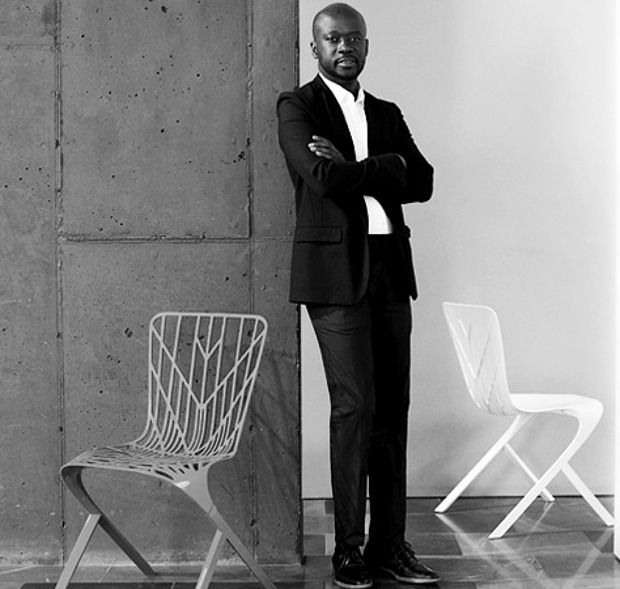 David Adjaye beside his Skeleton chair from his Washington collection for Knoll