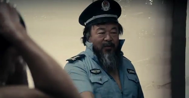 Ai Weiwei posing as a prison guard in his music video Dumbass, 2013