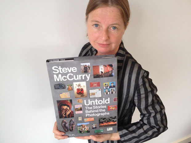 Phaidon publisher and editorial director Amanda Renshaw with a copy of Steve McCurry Untold