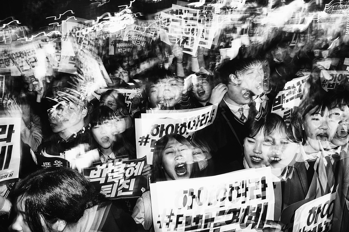 Student Protesters March. Among the most vocal and energetic groups taking part in the anti-president demonstrations are young South Korean students. © Argus Paul Estabrook.Street Series Winner, Magnum and LensCulture Photography Awards 2017