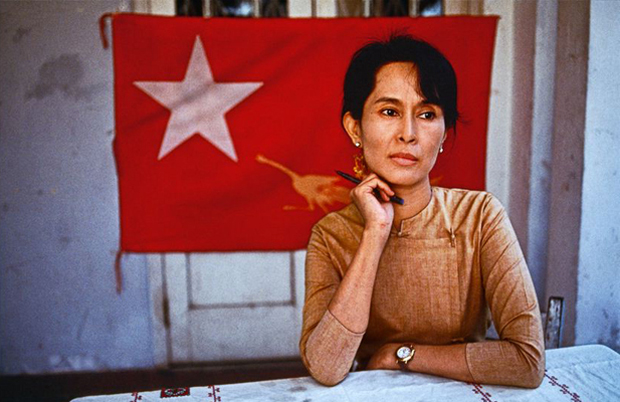 Steve McCurry, 'Aung San Suu Kyi and the flag' (1996), Rangoon, Burma