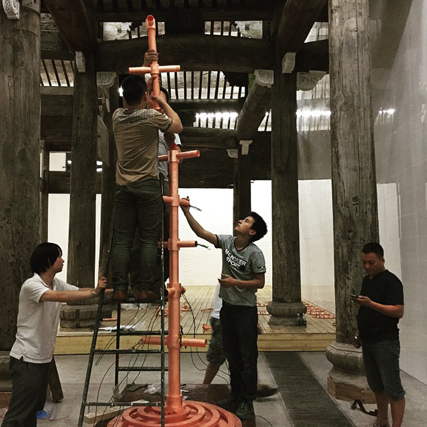 Workers installing Ai Weiwei's new show. Image courtesy of Ai Weiwei's Instagram
