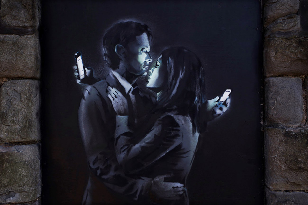 Detail from Banksy's Mobile Lovers (2014)