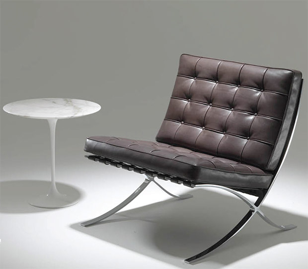 Knoll's new Relax edition of the Barcelona Chair, next to one of Eero Saarinen's tables