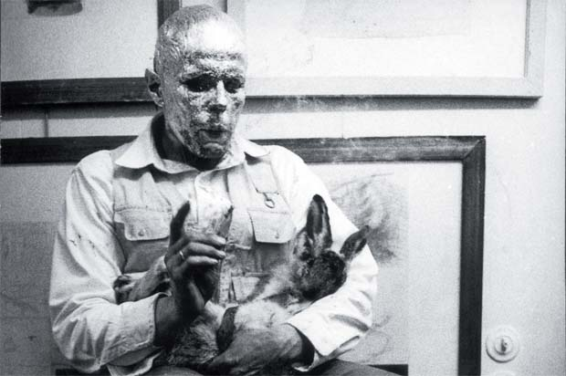 How to Explain Pictures to a Dead Hare (1965) by Joseph Beuys