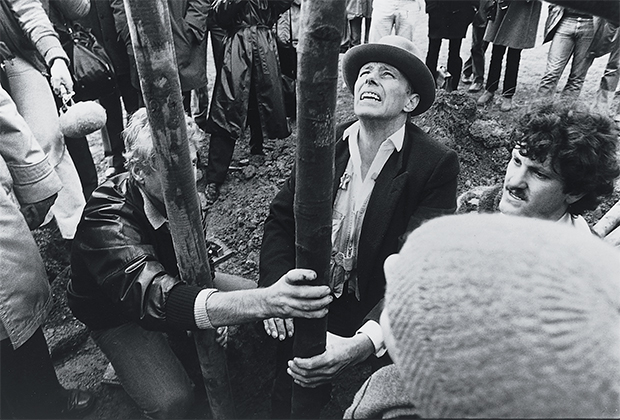 Joseph Beuys planting the first tree; 7000 Oaks, Documenta VII, Kassel, 1982