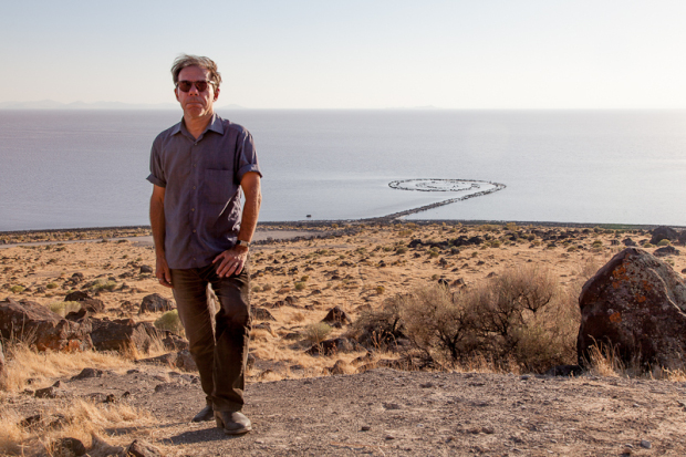 Bob Nickas beside Robert Smithson's Spiral Jetty, Utah. Photograph by Jason Metcalf