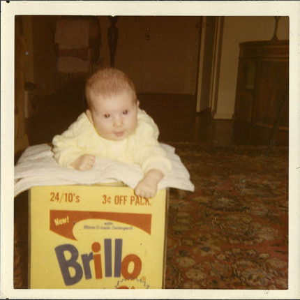 Lisanne on the Brillo box in a still from her new film Brillo Box (3¢ Off)
