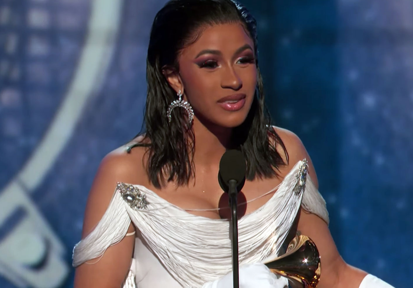 Cardi B accepts her award at the 2019 Grammys