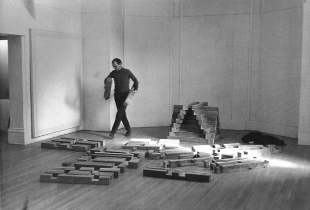 Carl Andre building Cedar piece, 1964