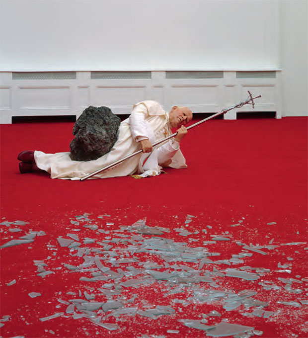 Maurizio Cattelan, La Nona Ora, 1999, wax, clothing, polyester resin with metallic powder, volcanic rock, carpet and glass, dimensions variable SALE 17 May 2001, New York ESTIMATE $400,000–$600,000/ £281,000–£421,400 SOLD $886,000/£622,325