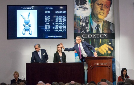 Bids being taken for Rabbit (1986) by Jeff Koons, at Christie's last night. The piece went for $91,075,000, setting a new record for a work by a living artist sold at auction. Image courtesy of Christie's