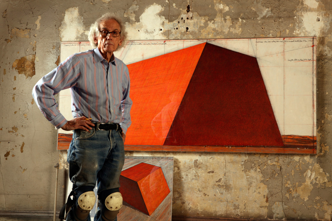 Christo with his Mastaba plans. Photograph by Wolfgang Volz. Image courtesy of the Serpentine
