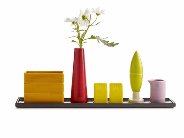 Condiment Architecture by Aldo Cibic. Cibic's a condiment-holder collection was inspired by the Italian countryside. The Cypress-tree holds toothpicks, the houses are salt and pepper shakers and the smokestack is a vase.