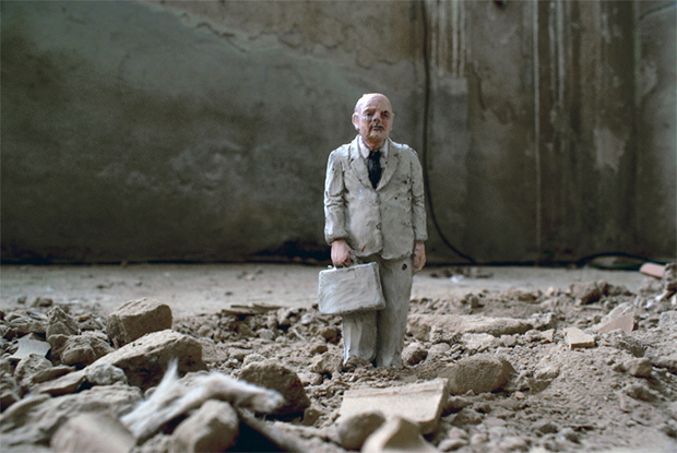 One of Isaac Cordal's cement figures stands alone