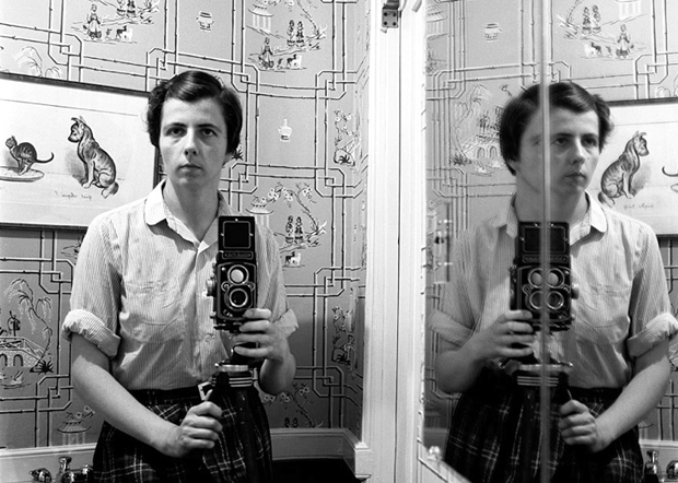 Vivian Maier takes one of her many blurry and distorted self-portraits, date unknown