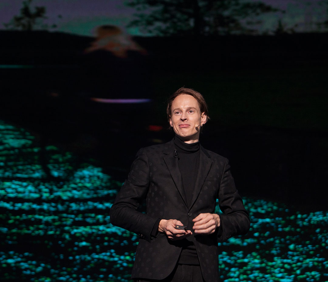 Daan Roosegaarde beside an image of his Van Gogh Bike Lane