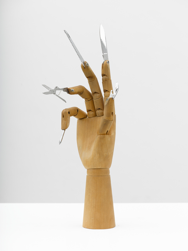 "Damián Ortega - The Part played by Labour in the Transition from Ape to Man. ""Darin Anteil der Arbeit an der Menschwerdung des Affen"" (F. Engel) 2013 Wooden hand model and steel knives - Photo: Ben Westoby Courtesy Freud Museum London White Cube"