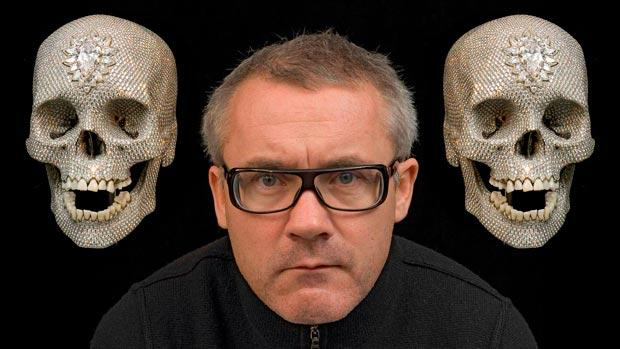 Damien Hirst pictured with two images of For The Love Of God (2007). Or is it Mick and Keith?