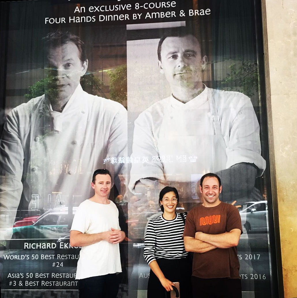 Dan stands beside a window display promoting his Amber dinner with Richard Ekkebus in Hong Kong. Image courtesy of Dan's Instagram