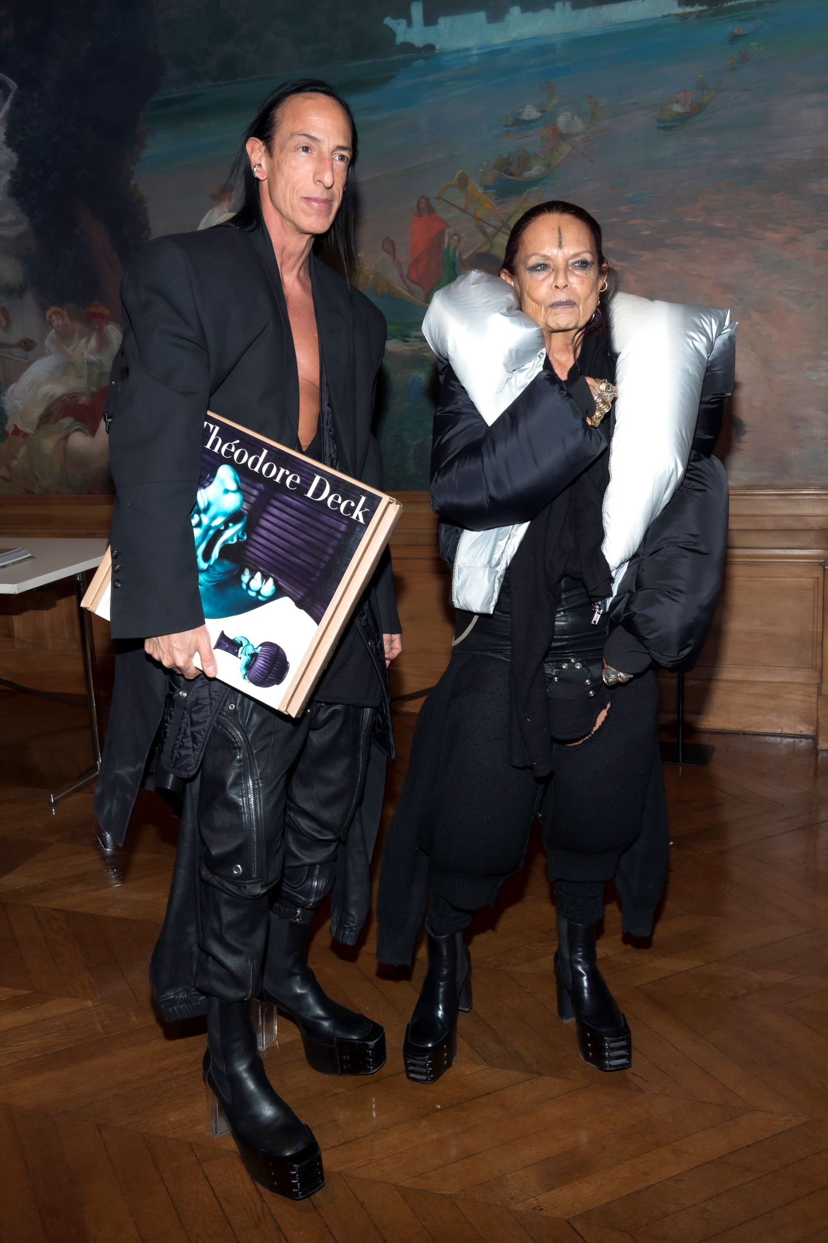 Rick Owens and Michèle Lamy at the Musée des Arts Décoratifs in Paris for Peter Marino's Théodore Deck book signing. Owens carries a copy of Théodore Deck. Photographs by Luc Castel