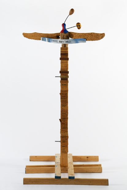 Jimmie Durham, Choose Any Three, 1989. Carved and painted wood, metal, and glass, 99 3/16 × 49 3/16 × 48 in. (251.9 × 124.9 × 121.9 cm), kurimanzutto, Mexico City. Courtesy the artist and kurimanzutto, Mexico City. © Jimmie Durham. Photograph by Jean Christophe Lett