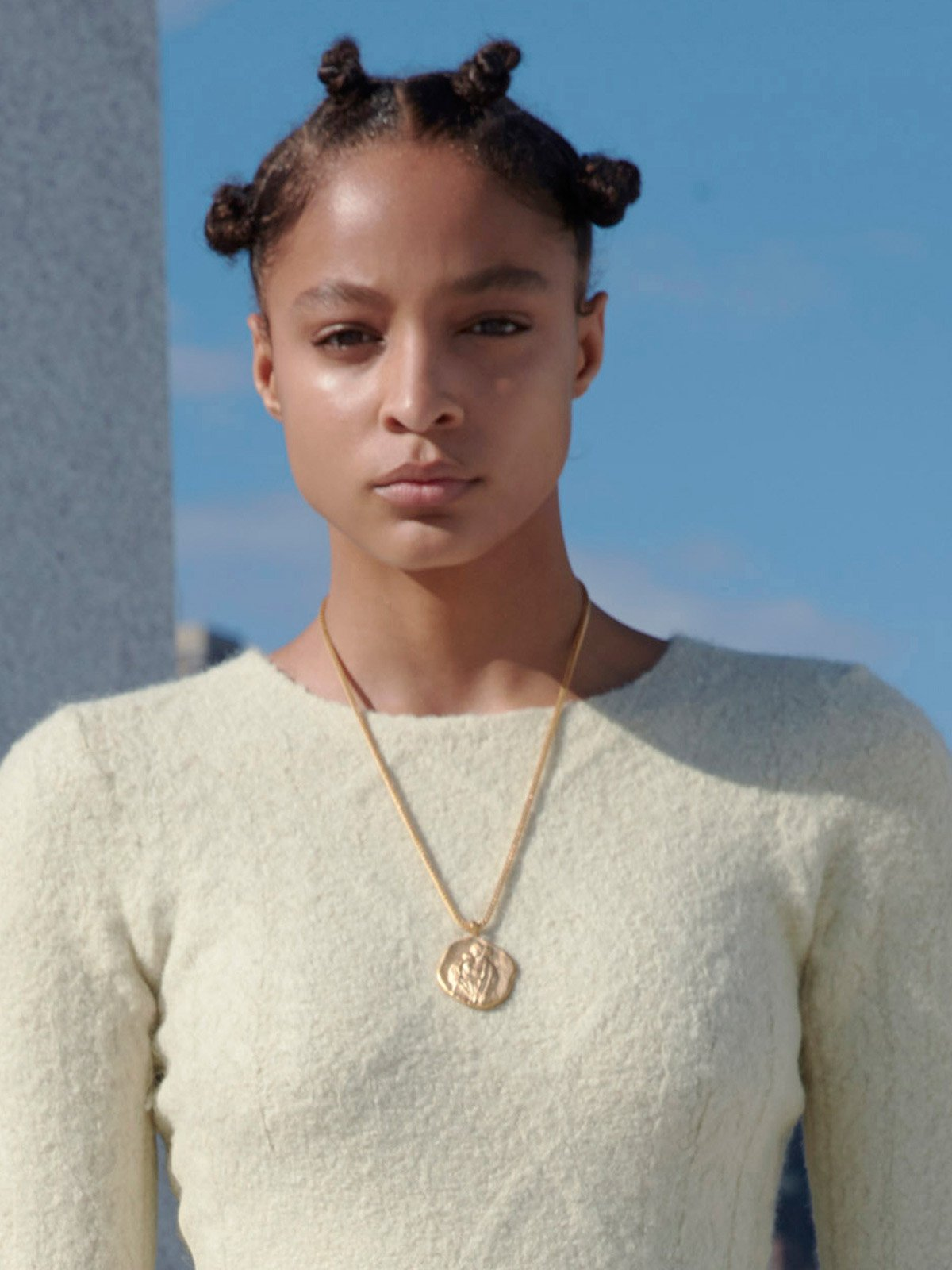 A model wears one of the Renaissance-inspired pieces from Kanye West's new Yeezy jewellery collection, at yeezysupply.com