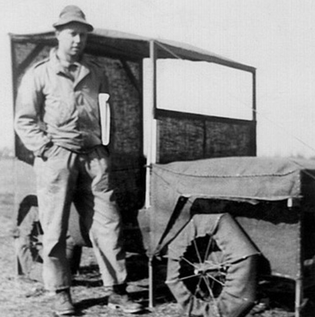 Ellsworth Kelly next to a Jeep during his days in a camouflage battalion