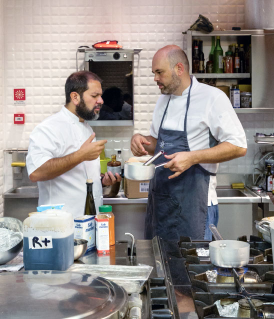 Enrique Olvera (left) with Carlos García at Massimo Bottura's Refettorio Ambrosiano. All images from Bread is Gold