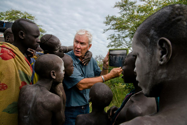 John Rowe with tribe members Copyright:  Steve McCurry