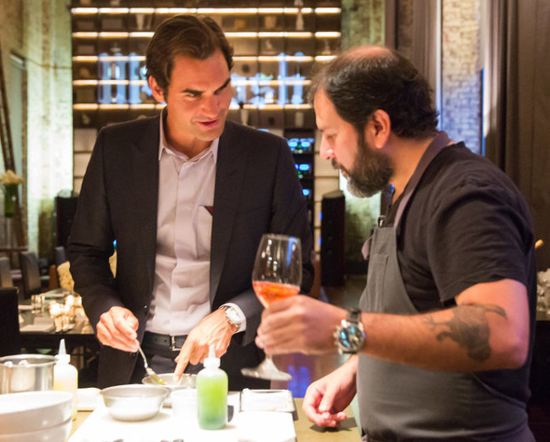 Roger Federer takes tips from Enrique Olvera on how to make scallop aguachile. Photograph by Ben Lozovsky for Moët & Chandon