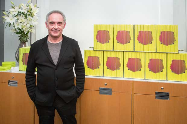 Ferran Adrià poses in front of ElBulli 2005-2011 photo by Scott Rudd