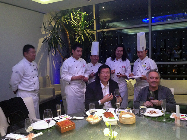 Adrià enjoying a suckling duck dinner with China's leading chef, Dong Zhenxiang, at Da Dong in Beijing, October 2015