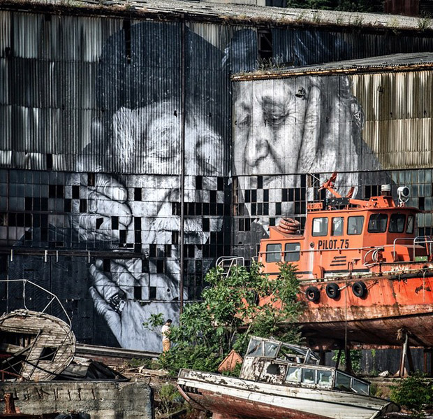 JR's portrait of Ali, an old fisherman from Istanbul, and his wife Sukran on the Old Docks, as part of the artist's latest iteration of The Wrinkles of the City. Image courtesy of JR's Instagram