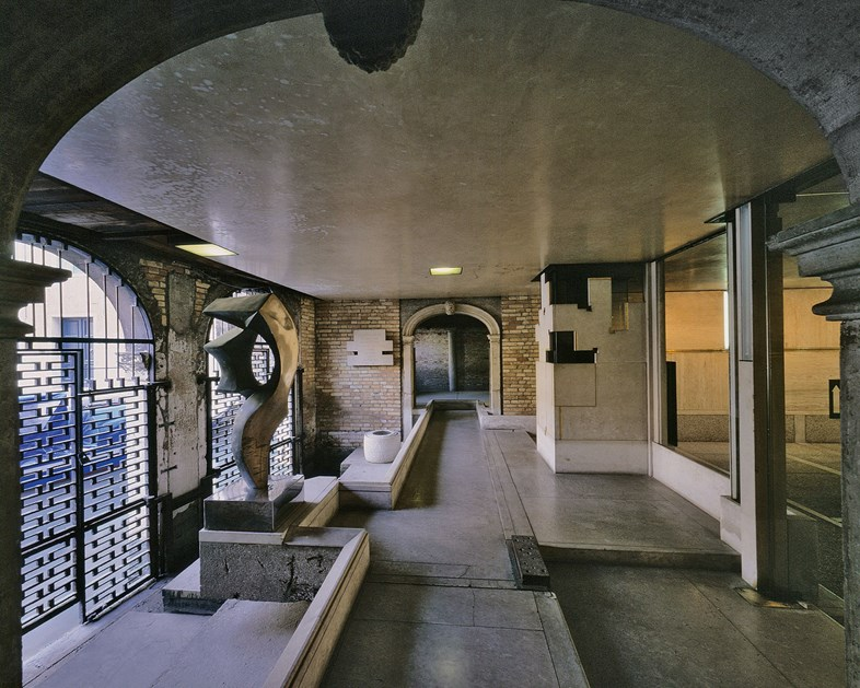 Fondazione Querini Stampalia renovations, Venice, 1961-63, view across water entry room from entrance hall, with the water gates (l) and radiator enclosure and glass wall (r). 