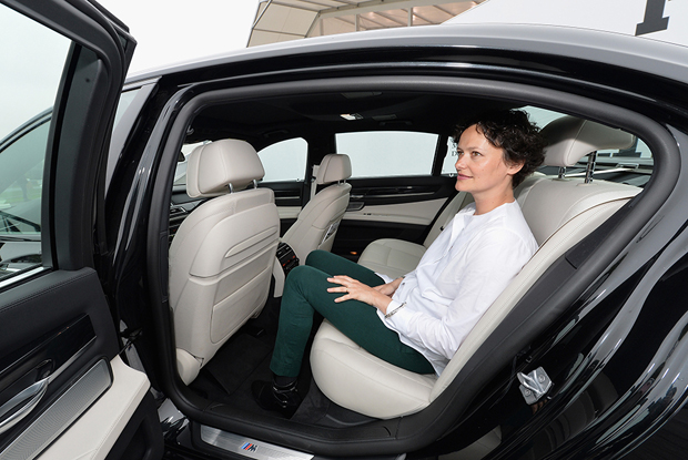 Frieze Sounds curator Cecilia Alemanii checks out the sounds in a BMW 7 Series at the New York fair earlier this year