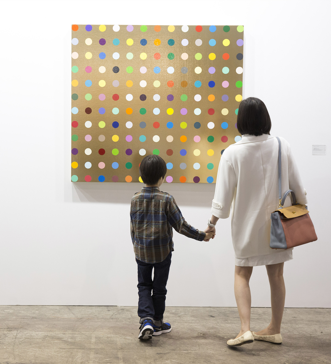 White Cube's booth at the fair this year, with a Damien Hirst spot painting