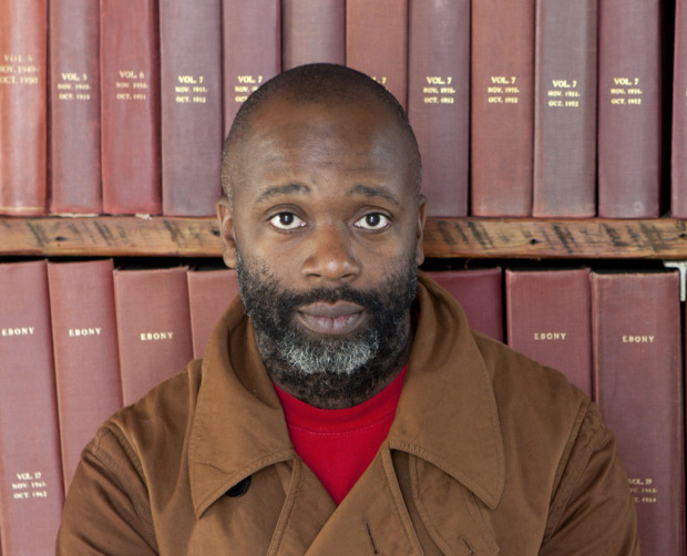 Theaster Gates with bound magazines from the Johnson Archive