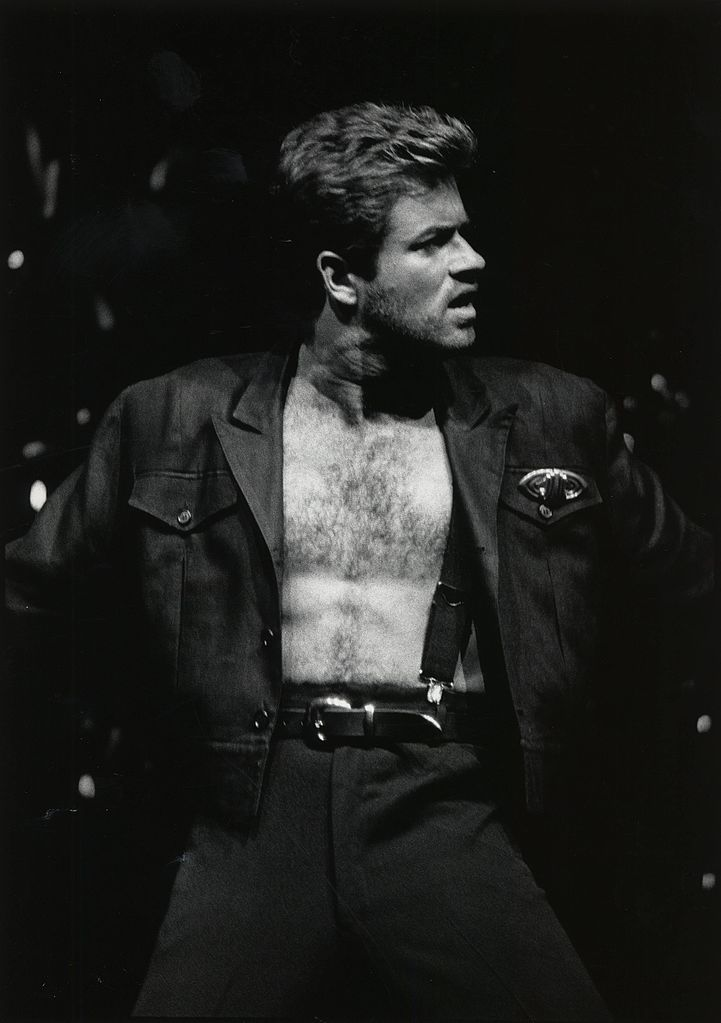 George Michael performing on stage during the Faith World Tour in 1988. Courtesy of the University of Houston Digital Library, public domain