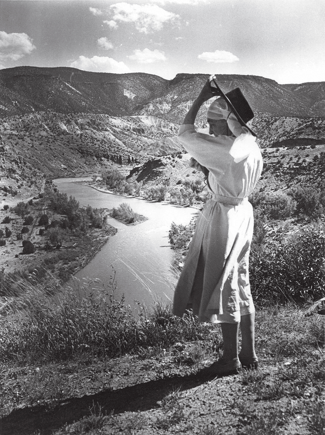 O'Keeffe in New Mexico , overlooking Chama River, 1961. © Todd Webb, Courtesy of Evans Gallery and Estate of Todd & Lucille Webb, Portland, Maine USA. As reproduced in our Georgia O'Keeffe book