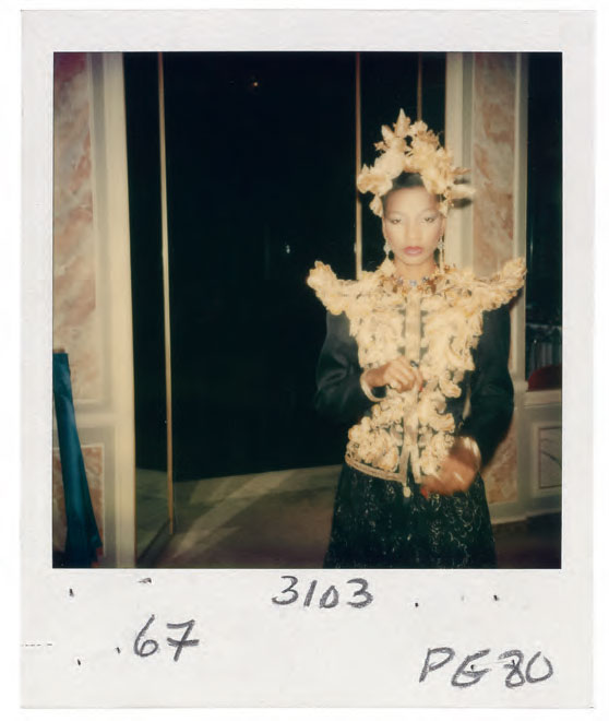 Headdress of gold flowers and leaves created by the designer Nina Wood, worn with a long evening outfit, Spring/Summer 1980 haute couture collection