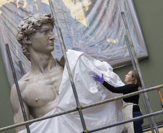 Conservator Johanna Puisto unveils the cast of Michelangelo's David post conservation, Nov 2014 in the Weston Cast Court