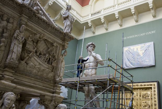 Conservator Johanna Puisto dusts the cast of Michelangelo's David post conservation, Nov 2014 in the Weston Cast Court