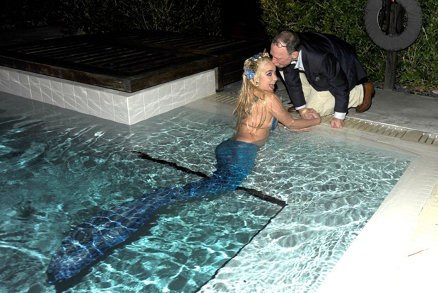 Anthony Haden-Guest kissing a mermaid at Art Basel Miami Beach, December 2009